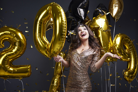 Cheerful woman enjoying at new years party