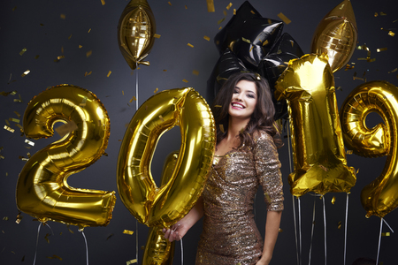 Excited woman celebrating new year 2019