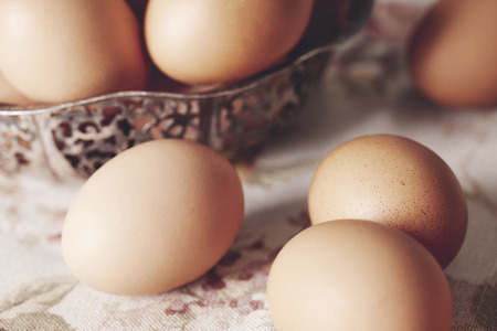 Close up of brown eggs on table