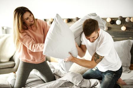 Cheerful couple enjoying at bedroom  Foto de archivo