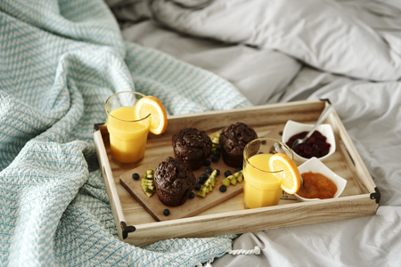Delicious breakfast on a tray in bedroom