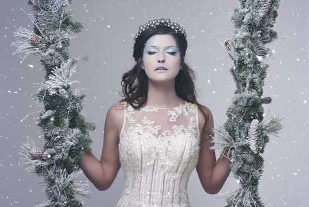Ice queen in wintry landscape