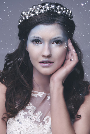 Front view of ice queen among snow falling  Imagens