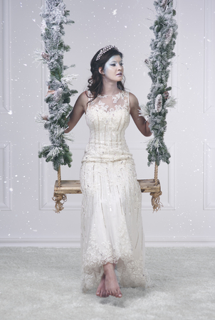 Barefoot ice queen on a swing