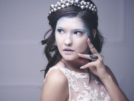 Pretty ice maiden at studio shot