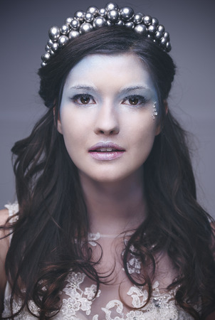 Portrait of ice queen or snow queen with crown