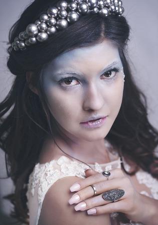Charming ice queen or snow queen at studio shot