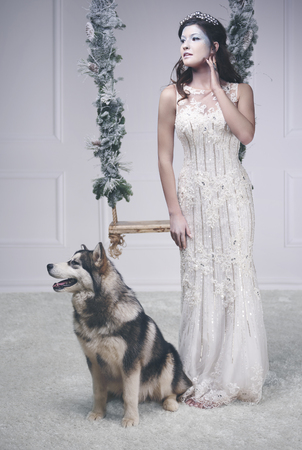 Full length portrait of ice queen with dog