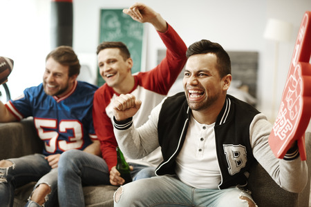 Cheerful men supporting their sport team  Stock Photo