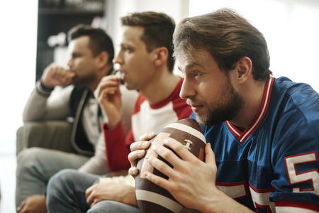 Focused watching football game at home
