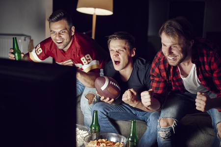Excited men supporting their team