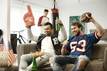 Football fans giving a cheer to their sport team  Stock Photo