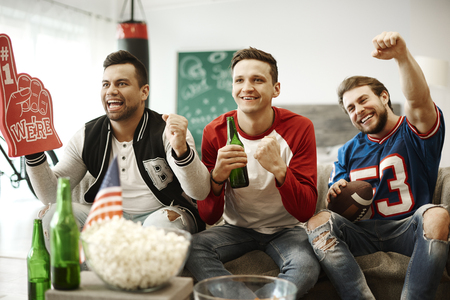 Football supporters cheering at home