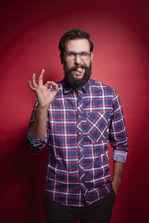 Man showing ok sign at studio shot