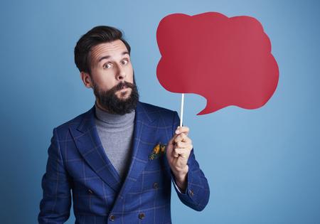 Man holding a speech bubble