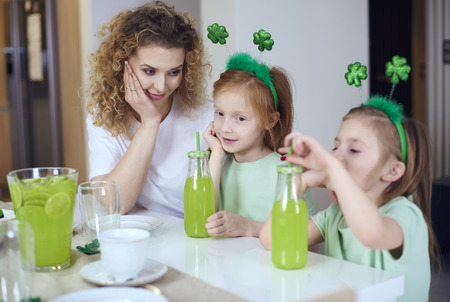 Woman with children celebrating Saint Patricks Day at home