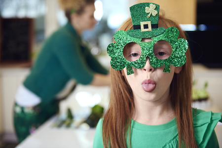 Portrait of playful girl celebrating Saint Patricks Day