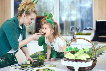 Mother with daughter cooking at kitchen  Stock Photo