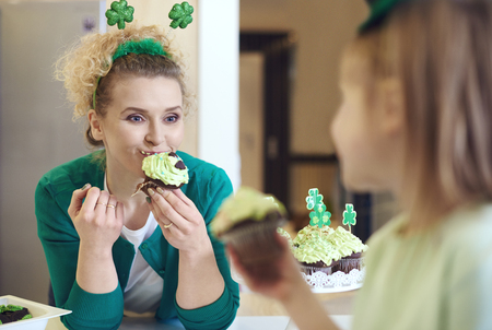 Woman eating tasty a cupcake