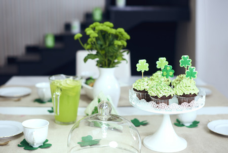 Table with sweet food at Saint Patricks Day Stock Photo