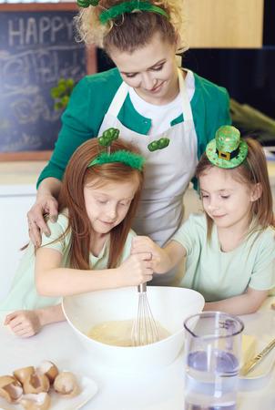Cheerful family baking at kitchen Stock Photo