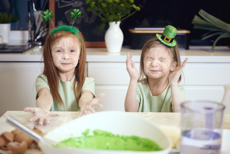 Cheerful siblings having a fun with flour   Stock Photo