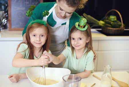 Portrait of family mixing dough  Stock Photo