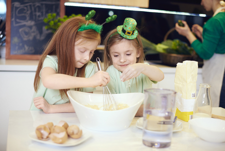Siblings making cookies at kitchen  Фото со стока