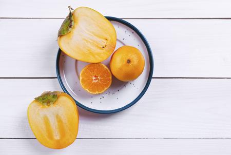Kaki and orange on plate
