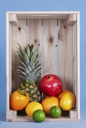 Exotic fruits in wooden crate