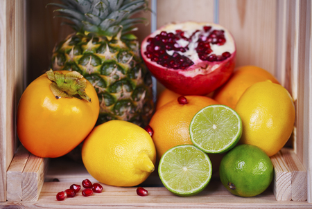 Various exotic fruit in wooden crate