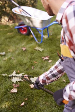 Part of man raking leaves  Stock Photo