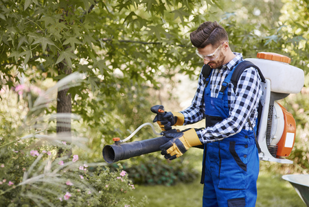 Gardener using modern gardening equipment  Stock Photo