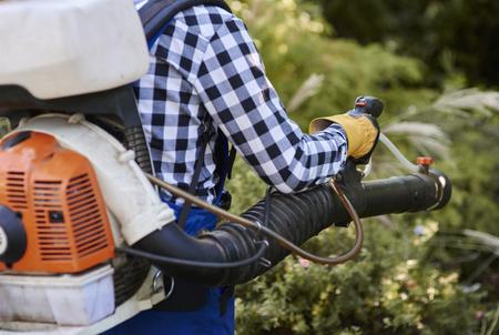 Man using modern leaf blower