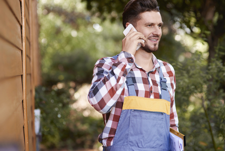 Farmer talking by mobile phone   Stock Photo