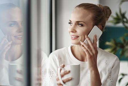 Cheerful businesswoman taking a break