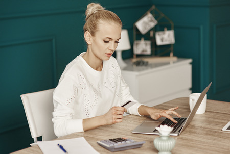 Woman doing online shopping at office
