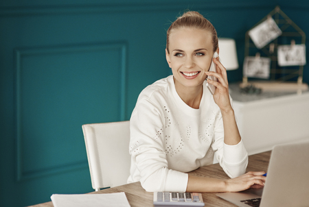 Happy businesswoman working at office  Stock Photo