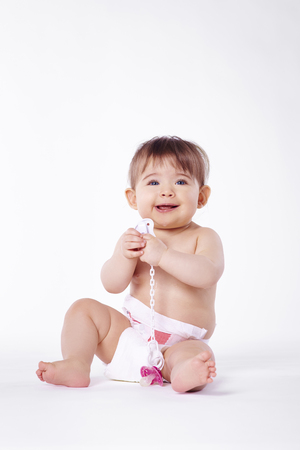 Portrait of cheerful baby in diaper 