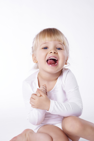 Baby laughing at studio shot