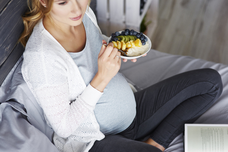 Pregnant woman relaxing at home