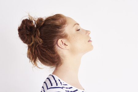 Profile view of woman's face at studio shot