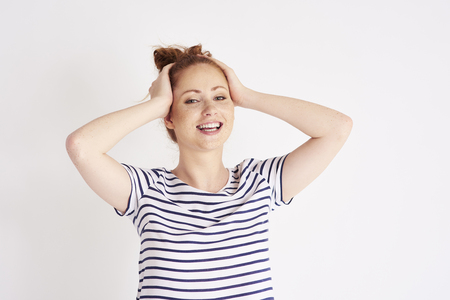Portrait of beautiful, young woman laughing at studio shot Stock Photo