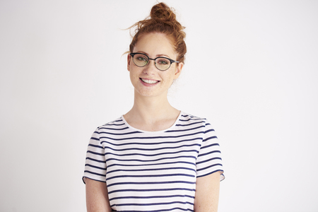 Portrait of young woman with glasses at studio shot