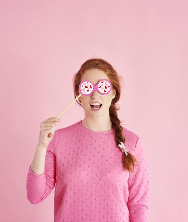 Portrait of playful girl celebrating valentines day at studio shot