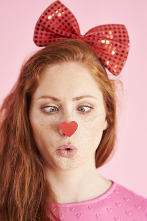 Playful woman making a face at studio shot Stock Photo