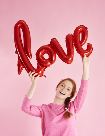 Portrait of cheerful girl celebrating Valentines Day Stock Photo