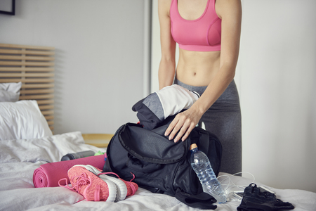 Woman packing bag for the gym Stock fotó - 106895914