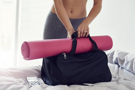 Preparing gym bag at home Stock Photo