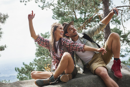 Couple making a selfie during hiking trip Stock Photo